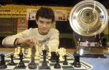 Posing over the board. The most difficult part of the tournament was to safely get the trophy home.